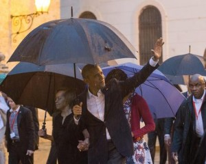 epa05223536 US President Barack Obama (front) waves upon his arrival to the Cathedral Havana, Cuba, 20 March 2016. US President Barack Obama arrives in Cuba for an official visit until 22 March to seal the process of rapprochement with the Communist-ruled island. Obama is accompanied by his wife Michelle, his daughters Malia and Sasha, and his mother-in-law Marian Robinson. The visit of Obama to Cuba from 20 to 22 March 2016 is the first visit of a US president to Cuba since US President Calvin Coolidge's visit 88 years ago. EPA/ROLANDO PUJOL
